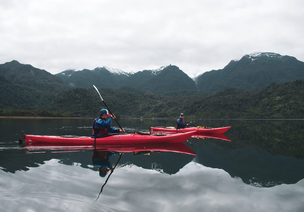 Chile, Puyuhuapi, Charlie kayaking in the fjords
