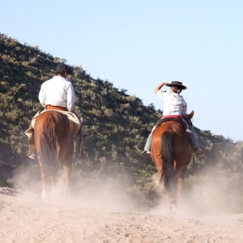 Colombia, Father and Son as Cowboys riding side by side
