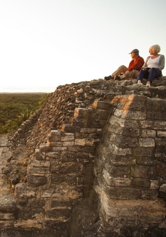 Couple at sunset on the Amanai Ruins, Belize