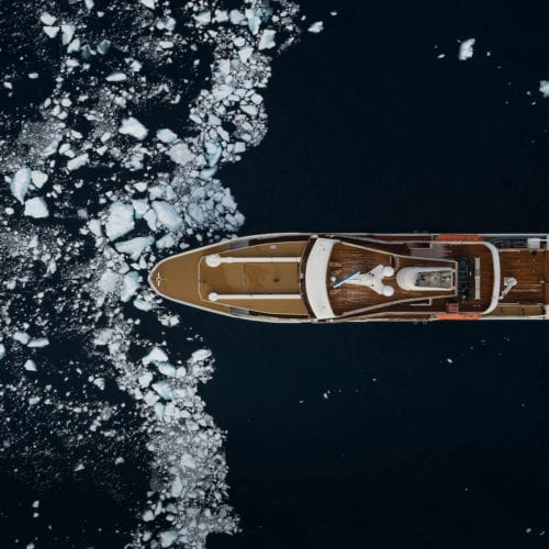 Aerial of a yacht heading into Antarctica's icy waters