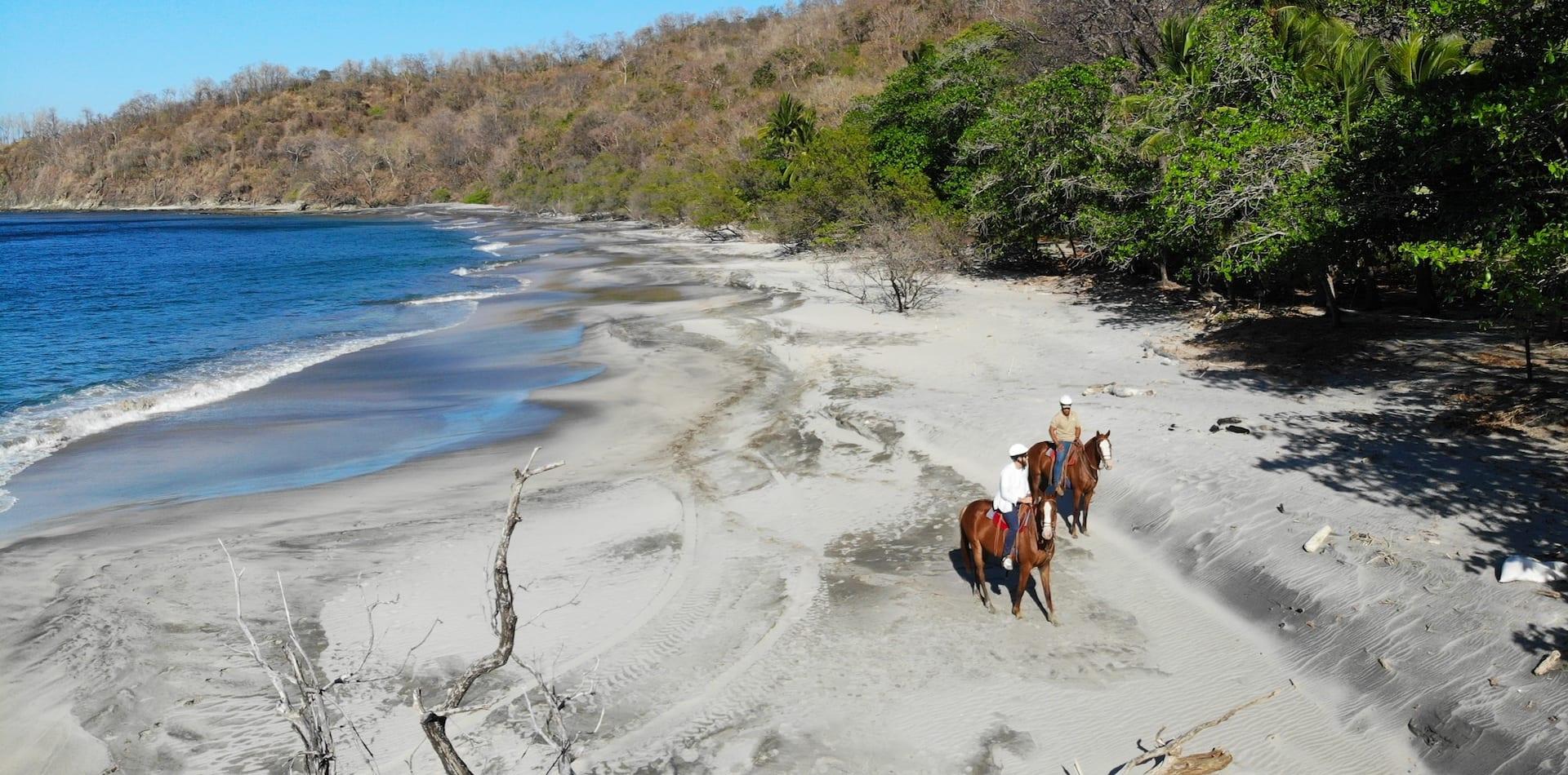 Horse riding along the beach in Cabo Vela, Costa Rica
