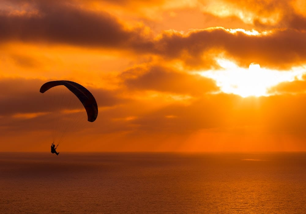 Microlight for Ocean Exploration at Sunset