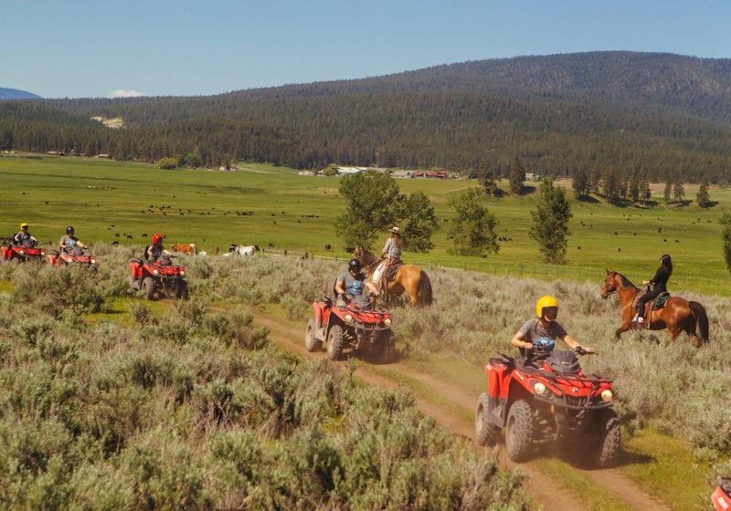 USA, Montana quad biking horse riding