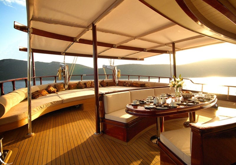 RIANA Yacht Dining on Deck at Sunset Exterior
