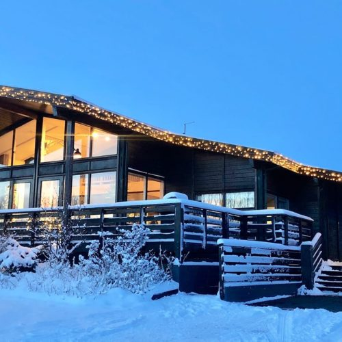 Iceland Úlfljótsskáli Lodge Exterior At Dusk Hero Image